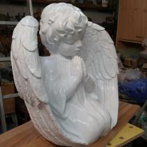Ангел для памятника. Высота ангела для памятника - 56 см., глубина скульптуры ангела - 30 см., ширина скульптуры ангела - 60 см.