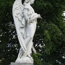 На фото скульптура ангела на колонне. Стоимость ангела из полимера сегодня - согласно разработанного проекта памятника.