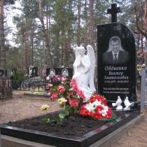 Скульптура ангела с памятником из гранита. Цена ритуального комплекса из гранита со скульптурой ангела, под ключ 70 тыс.грн. Фото скульптуры ангела, установленного на одном из кладбищ Киевской области.